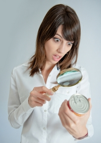 Shocked woman inspecting a nutrition label